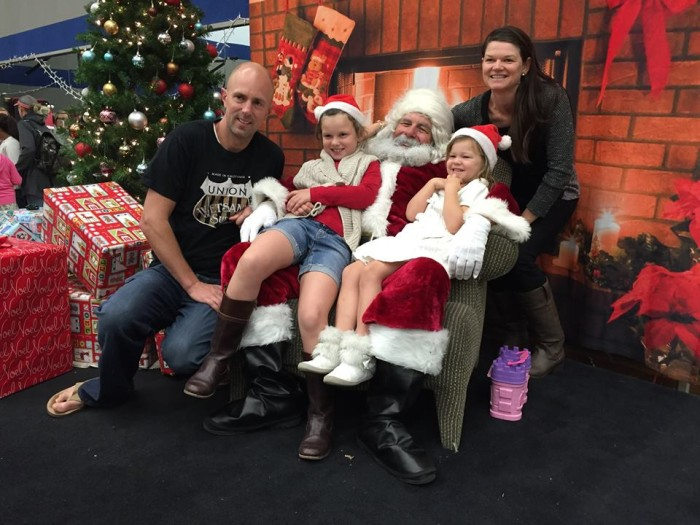 The Myers family enjoying time spent with Santa at the YMCA.