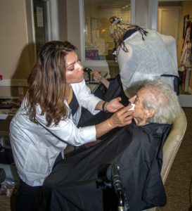 Pearl Andress getting facial by Lena Terry and Cheryl McDaniel getting a haircut by Diana Ornelas.