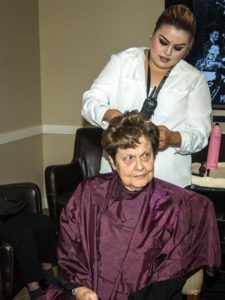 Cheryl McDaniel getting a haircut by Diana Ornelas.