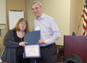 Katherine Raley, Health Insurance Counseling & Advocacy Program (HICAP) Program Manager, accepts an award from Phil Chandler, Mended Hearts Program chair, after a presentation on Medicare.