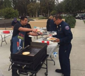 Fire Chief David Endaya serving up breakfast for National EMS Week.