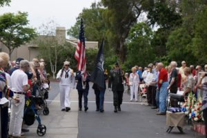 A military Color Guard from the 1st Memorial Honors Detail, representing the different branches of the military, present arms at a previous Salute To Our Veterans event at Cypress Place Senior Living in Ventura. Photo by Michael Gordon