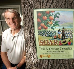 Former Ventura city council member, and current Ventura County Supervisor, Steve Bennett was a  co–founder of SOAR, Ventura County's aggressive growth–control movement. He is shown with a October 2005 poster recognizing the tenth anniversary of SOAR.