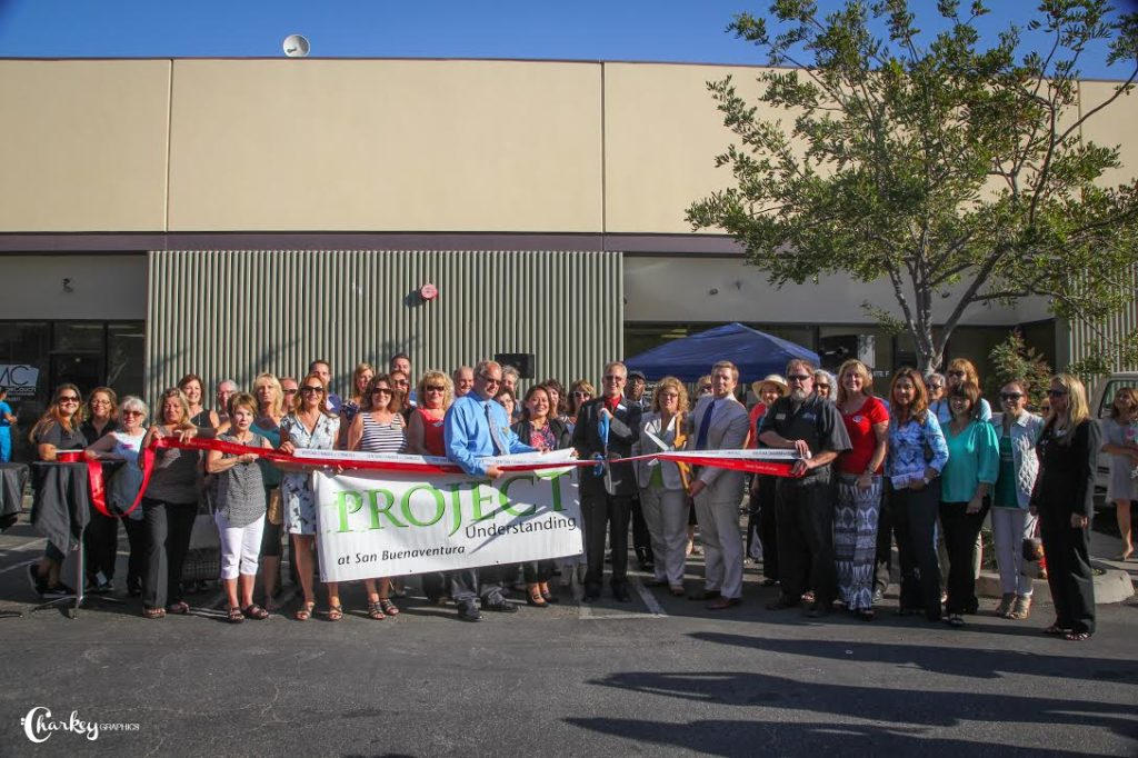 Project Understanding celebrates with ribbon cutting at their new location.Photo by Charleen Morla