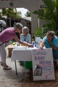 Helping raise funds at a garage sale for Buddy Nation are Rebecca Nelson , Cappi Patterson and Penny Balicai. Photo by Bernie Goldstein