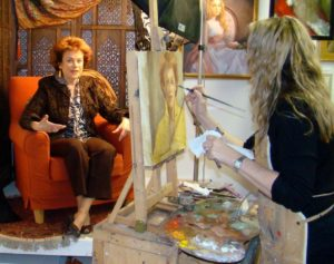 """In 2015 Johanna Spinks painted the portrait of Sandra Laby for The Face of Ventura series appearing on the Ventura Breeze. In remembering Sandra, artist Johanna Spinks said """"Sandra sat for The Face of Ventura and just had an effervescence to her spirit and personality that I enjoyed being around. When her gaze was on you, when she pulled you in for a photo op, with her arm protectively around you, you felt so blessed. When she talked directly to you, about art and life, how she met Jordan, you felt like the luckiest gal in the room."""""""