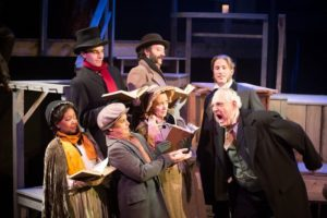 Peter Van Norden (far right) stars as Ebenezer Scrooge, with the company, in the Rubicon Theatre Company production of A Christmas Carol. Photo by Jeanne Tanner